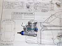Name: SAM_2912.jpg Views: 44 Size: 223.0 KB Description: The engine is larger than the 40 on the plans :( and the carb will stick out.  Need to trim some of the radials.  No room for a large engine mount!!!