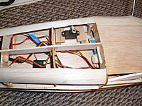 Name: SAM_2921.jpg Views: 43 Size: 260.9 KB Description: Even with the disaster with the tapping, at least now I know where the throttle linkages will need to exit the firewall.  Here it is installed under the cabin floor.