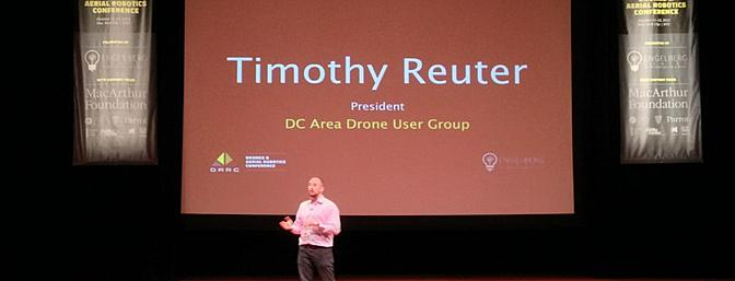 Timothy Reuter speaking at the Drones & Aerial Robotics Conference.