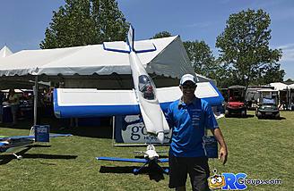Ali holding the Hangar 9 Van's RV-4 at the Horizon Hobby booth front and center at Joe Nall 2017