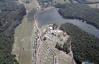 Camping, show central, the hanger, lake and electric line all seen in this photo