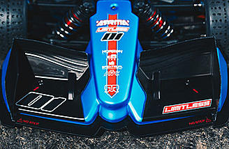 Aerodynamic nose-cone and front wing with a splitter to increase downforce and provide maximum control