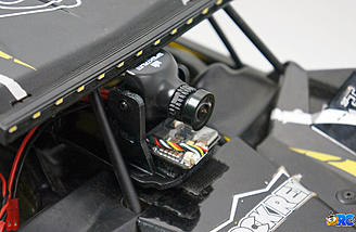 The FPV pod is secured to the hood with Velcro