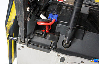Battery is secured by the door and connected to the EC3 connector.