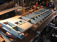 Name: Gluing in joiner tubes.jpg Views: 26 Size: 569.7 KB Description: Wing inner section fitted up to the left wing here to provide alignment for the wing joiner tube. The remaining wing spar is then wrapped with the Dyneema (rather tediously), after.