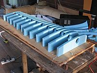 Name: Spar holes cut.JPG Views: 50 Size: 337.1 KB Description: A pilot hole was first made with a heated metal rod. Then the hot wire was threaded through. Both ends held outside the wire clips, power applied and the hole cut by rotating the ends slowly.