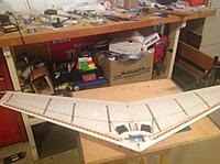 Name: BeeCore.jpg Views: 146 Size: 245.8 KB Description: This is what I'm talking about. Bottom view showing LED's, spar, servos, battery... ready for lam film covering and further equipment installation. Yes, shop is a mess... Wife is pissed.