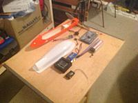 Name: BeeStuff.jpg Views: 127 Size: 241.4 KB Description: Here's some of the stuff yet to be installed. Upper deck is white and will hold the KK board, lipo pack, LED wiring, etc. Orange thing is optional lower pod with motor, lipo and FVP stuff. Sorry, the FVP equipment is still in transit.