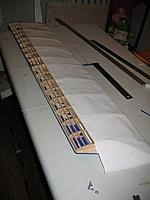 Name: 003.jpg Views: 111 Size: 124.7 KB Description: Ironing the Solar Film to the aft turbulator strip topside