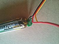 Name: IMG_20140516_101703.jpg Views: 309 Size: 894.6 KB Description: Place a piece of tape over the end under the battery protector