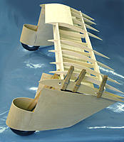 Name: Dragonfly 05.jpg Views: 332 Size: 137.4 KB Description: The top and bottom of ribs are mainly used to shape the wing airfoil and link together the spars. Rather than cut away (and waste) material to form lightening holes, why put the material there in the first place?