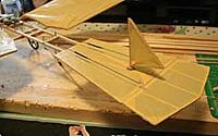 Name: 12-11-24_Fokker-Spin-3_4147.jpg Views: 89 Size: 6.9 KB Description: Tail section.  Rudder is all-moving top and bottom.  Ply washer keeps unit in place.  Ruder CA'd to a 1/16 inch dowel.