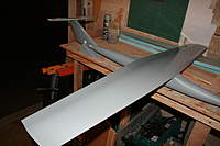 Name: DC60_FusePlug_PrimedMockup (14).jpg Views: 144 Size: 58.3 KB Description: The revised vertical tail will be slightly taller with less rake angle, but will preserve the current tail moments.