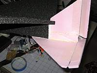 Name: Something New3.jpg Views: 195 Size: 67.4 KB Description: The new EPP fuselage and wings are mated to the old EPS tail assembly. The wing rests in a notch of the vert stab, just like other Smart Dart-based plane designs.