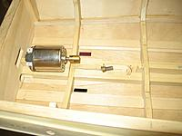 Name: IMG_2342 (Custom).jpg Views: 193 Size: 141.3 KB Description: Most likely solution is to mount motor in stern and build a small gear set that will mount in front of propshaft and tie everything together.