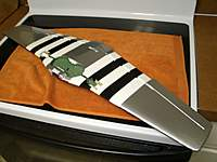 Name: wc_05.jpg Views: 115 Size: 54.9 KB Description: Silver with high contrast invasion stripes on the bottom.  Control surfaces are hinged now too. Weight at this point is 3.7 ounces.