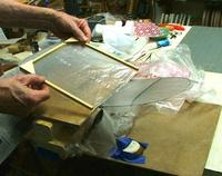 Name: l-DSCF4189.jpg Views: 432 Size: 66.6 KB Description: The wax paper is removed from under the wing and the frame is angled to stick the vinyl first to the root rib.