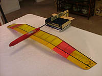 Name: DSCF4735.jpg Views: 195 Size: 73.6 KB Description: First shim up and make the table level. Then stack books to make the boom level when it is sitting on the stab saddle.  Then glue the saddle to boom.  No clamps needed, but you could put a weight on the boom to hold in place while glue sets up.