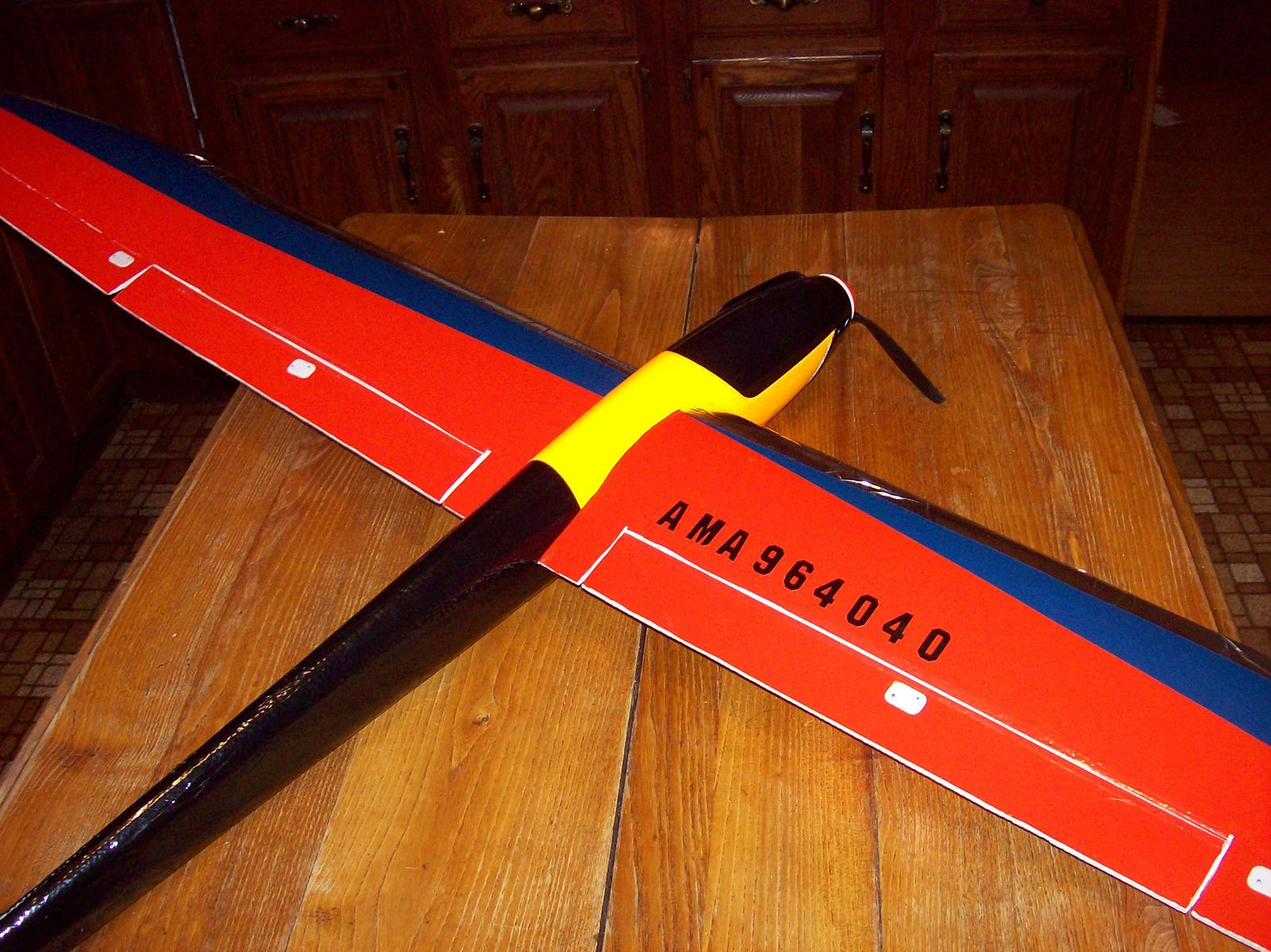 """Name: Radian Pro top view.jpg Views: 561 Size: 259.4 KB Description: Insignia Blue and Insignia Red Econocoat for wings, black Econocoat for tial boom and florescent orange trim sheeting for front of fuse.  Also, 1"""" vinyl letters for AMA number."""
