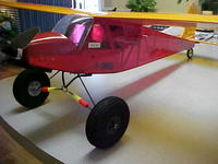 Name: MVC-154S.jpg Views: 304 Size: 30.2 KB Description: Decided to paint outide of rims black and added a larger tail wheel. Flew it yesterday for first time with new set up and it is sweet and rolls through the grass like it isn't even there! I have just as much fun landing and taking off as I do flying.