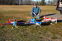 """Name: A few sweet flyers.jpg Views: 229 Size: 251.4 KB Description: Can't say I don't shop around! Front row L to R Addiction X, by Precision aerobatics, Hobby King's, 51"""" Slick, And 3DHS 51"""" AJ Slick  Back row L to R Parkzone's old reliable T_28 in Blaze orange and E-flight's PT-17 Stearman"""