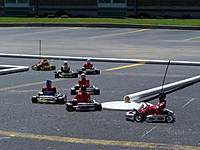 Name: rc kart racing.jpg Views: 201 Size: 19.0 KB Description: Final hairpin turn for this outdoor race