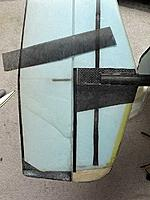 Name: tail_wrinkle-2.jpg Views: 184 Size: 70.0 KB Description: Foam wrinkle repaired with carbon mat.  Subtail reinforced with some additional unidirectional carbon along the hinge line. Repair has resulted in very little weight gain and no effect on flying.