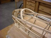 Name: DSCN0462.jpg Views: 457 Size: 67.1 KB Description: The from canopy/cockpit support proved to be a little stinker. I have a few hours in on this. I had to make a light ply arch the support it with 1/4 balsa, this was sanded to shape to get a nice contour and everything matched.