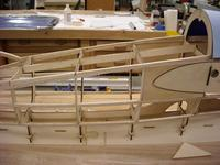 Name: DSCN0463.jpg Views: 428 Size: 72.3 KB Description: Here I have added some ply behind the from are of the wing rib, this is to prevent the wing from crushing in the fuse in the event of a rough landing .    Hmmmmmm, must have seen me fly before.