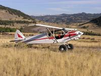 Name: Red and white Super Cub in Wyoming.jpg Views: 635 Size: 131.1 KB Description: Super Cub, showing different shape to rudder, and air cleaner tunnel under cowl.