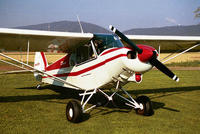 Name: red and white Super Cub, front.jpg Views: 290 Size: 51.7 KB Description: Note how the fuselage doesn't taper much toward the nose.  Also shows the air cleaner cap in the end of the tunnel under cowl.