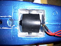 Name: 100_2048.jpg Views: 473 Size: 66.9 KB Description: 70mm fan sitting in place. you can see its right up next to those plastic screw mounts in the fuse.  the start of the fan body is also located in the same place as stock 64mm