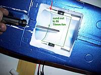 Name: enlarge here.jpg Views: 504 Size: 123.6 KB Description: sand out this area to fit the 70mm fan red arrow points to where the old fan had a flared lip at its intake. i used that groove as a guide to mount the new fan's intake level with the same point.