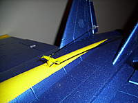 Name: 100_2077.jpg Views: 466 Size: 83.4 KB Description: mounting tabs were carefully cut from the servo so it can sit lower into the fuse for a cleaner look. i also connected the Z bends from the bottom up, so the cut end of the wire doesnt dig into the foam fuse