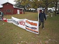 Name: TangerineFriDlg 032.jpg Views: 46 Size: 309.1 KB Description: Some help erecting the sponsors banners