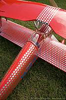 Name: bomber_field_2010_img_0086_040_std.jpg Views: 210 Size: 99.1 KB Description: Loved the deco on this biplane.