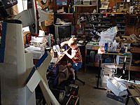 Name: ryan_workshop.jpg Views: 240 Size: 146.7 KB Description: My current garage.  Son working with tools.