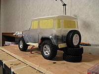 Name: LC 40-016.jpg Views: 248 Size: 63.0 KB Description: I'd like to figure out a spare-tire rack for this thing....