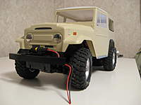 Name: LC 40-009.jpg Views: 252 Size: 42.1 KB Description: The winch came form a Stomper toy that was embelished with additional scale parts.