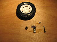 Name: LC 40-014.jpg Views: 196 Size: 71.6 KB Description: A great spare tire mount can be built from the spare servo mount and the plastic spacer (Both are extra kit parts)