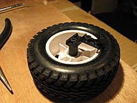 Name: LC 40-021.jpg Views: 206 Size: 67.8 KB Description: Here it is attached to the tire...