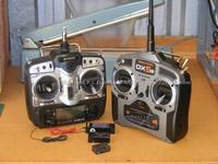Name: picDSCF0141.jpg Views: 125 Size: 82.8 KB Description: Trusty JR X2610 alongside the new Spektrum DX5e.  In front are the GWS R8MSL+, JR RS77S and Spektrum AR500 receivers.