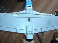 Name: P51 CG (1).jpg Views: 171 Size: 63.2 KB Description: coat hanger wire installed with hot glue. I had to dig a trench to deepen it to fit.