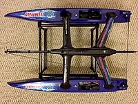 Name: image-b5b418bb.jpg Views: 381 Size: 1.04 MB Description: Not Shown: Some foam tape is applied to the stand which keeps the hulls in place. It fits perfectly, but the stand isn't foldable; two tubes slide into the sides for assembly.