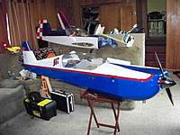 Name: 100_0268.jpg Views: 58 Size: 90.5 KB Description: The 40% Robert Godfrey and the 33% Great Planes Extra 330, need to finish it !!!