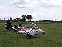 Name: DSCF2003.JPG Views: 115 Size: 498.7 KB Description: Horizon Hobby jet team with the  F-86 Skyblazers.