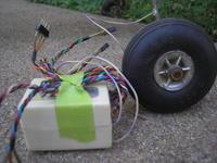 """Name: P8231336.jpg Views: 162 Size: 84.2 KB Description: RX size comparison up next to a 2.5"""" Du-Bro wheel"""