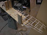 Name: PC231944.jpg Views: 189 Size: 58.2 KB Description: All I did was flip the Caravan over in the jig and glue on the bottom formers.