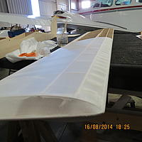 Name: 011.jpg Views: 133 Size: 327.4 KB Description: A look down the wing, with the tip completed.  One more surface to go.