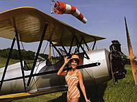 Name: pretty%20girl%20with%20ww2%20airplane.jpg